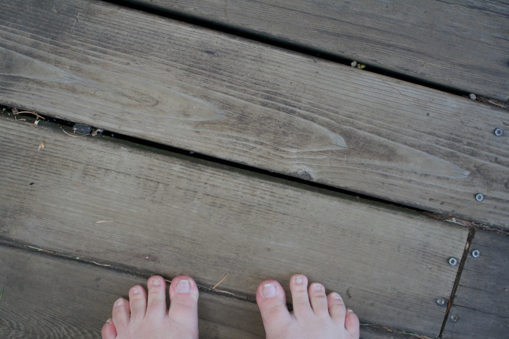 my toes on an awkwardly clean section of deck after I scrubbed it