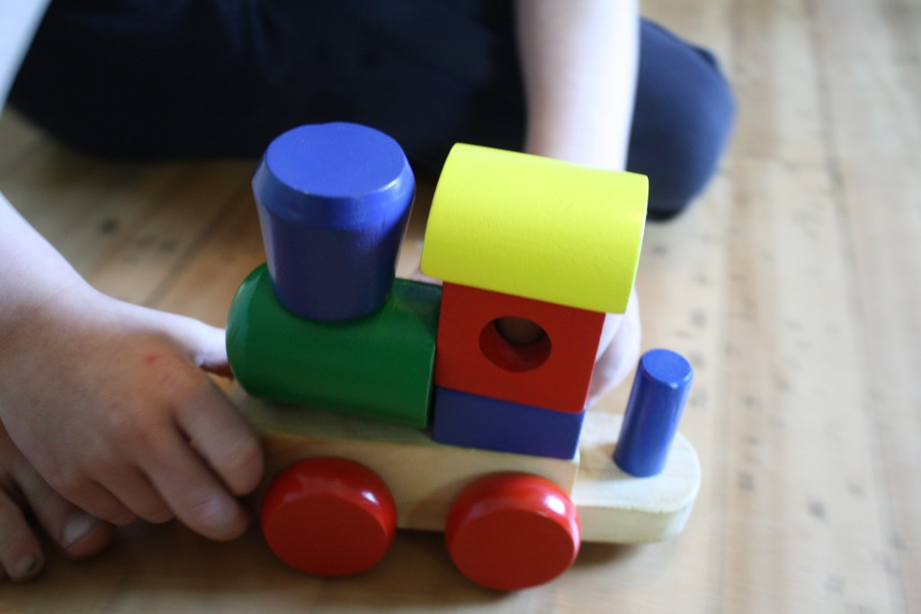wooden train built from colorful blocks