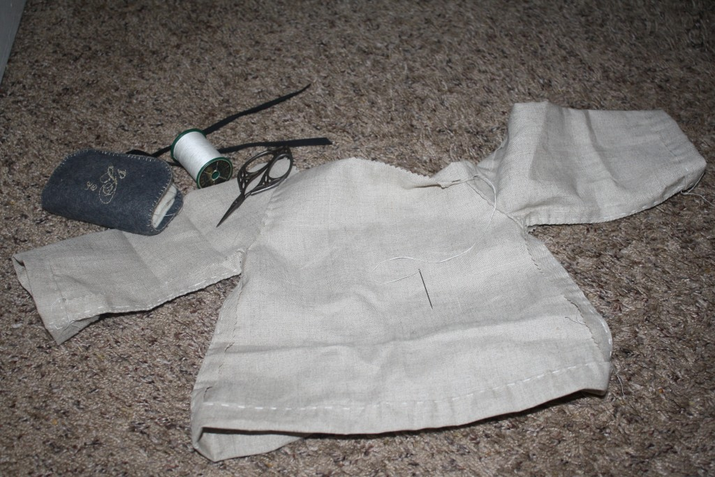 natural linen baby tunic in progress with sewing tools