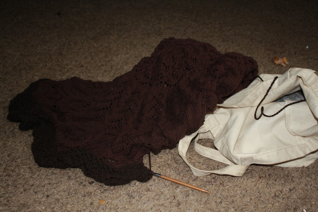 what it looks like when I take the blanket i'm knitting out of my work bag-- a big floppy mess of knitting